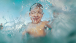 He likes to splash water in the pool, it's so funny Footage
