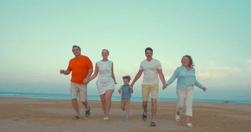 Bih happy family running on the beach Footage