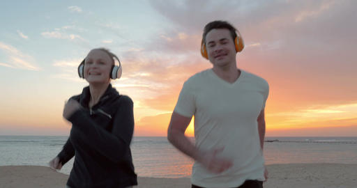 Two Friends Running in Lights of the Rising or Setting Sun Footage