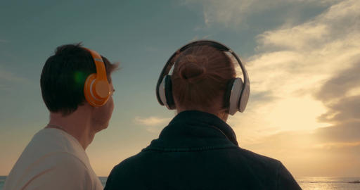 He and she admiring evening sun over the sea Footage
