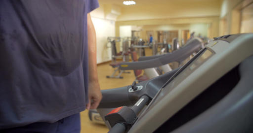 Man finishing his workout on treadmill Footage