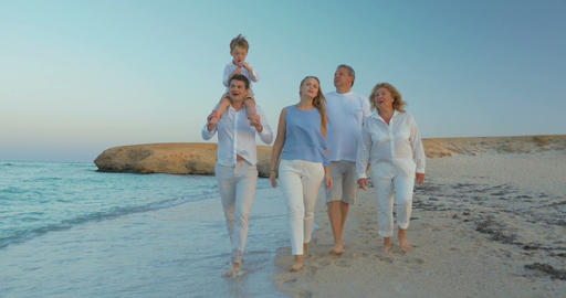 Big Family Walking by the Sea Footage