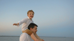 Child showing plane sitting on fathers shoulders Footage
