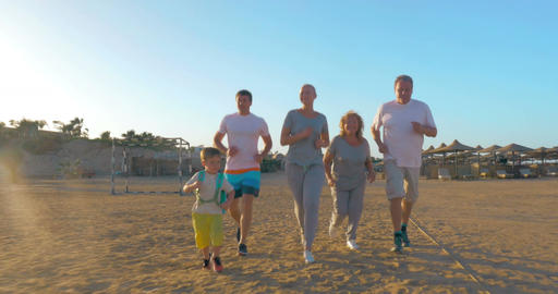 Sportive family running on the beach Footage