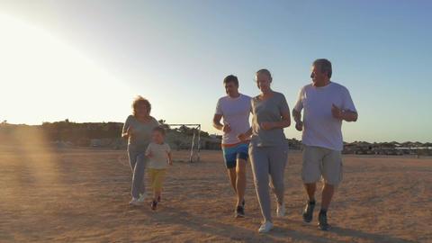 Happy family finishing evening jogging Footage