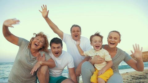 Big happy family waving hands at the seaside Footage