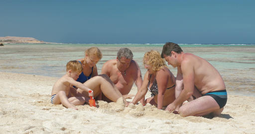 Big family building sand castle together Footage