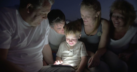 Big Family Watching Bedtime Story on Tablet PC Footage