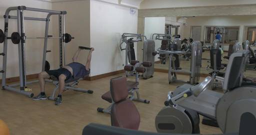 Two people working out in fitness center Footage