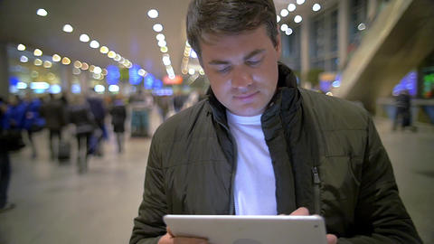 Man using electronic tablet at the station Footage