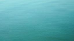 Turquoise Water In Lake, Water circles , Splashing By Hand Footage