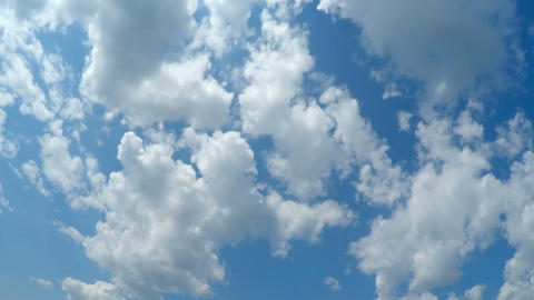 White Fluffy Clouds over Blue Sky Live Action