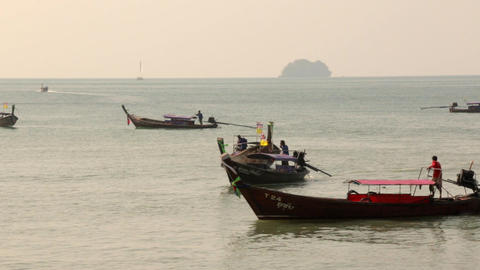 Wooden Long-tail Boats Are Moving Near A Tourist Beach In Ao Nang, Krabi, Thaila stock footage