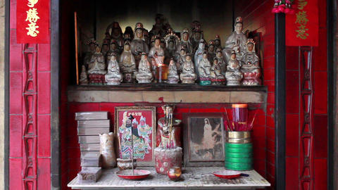 Altar of small street side Chinese shrine in Macau Footage