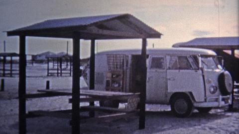1971: Hippie VW van parked beach girls scenes Footage