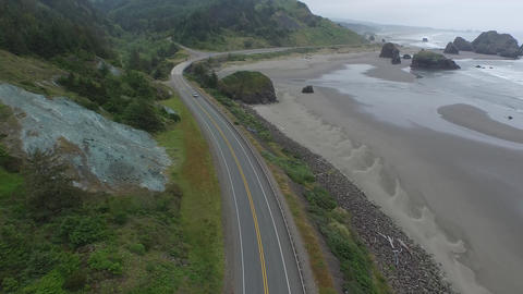 Aerial wide shot of a highway on the beach in oregon Footage
