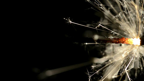 Closeup of Sparkler in the dark lit by Hand Footage