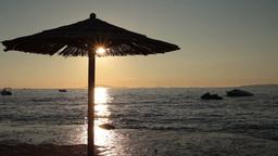 beach umbrella during sunset Footage