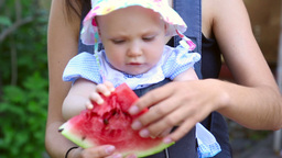 Six month baby girl with watermelon Live Action