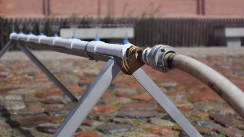 City Water Sprinkler stock footage