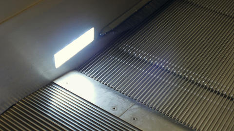 Moving staircase with light at trainstation Footage