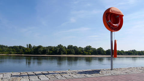 Lifebuoy on the river bank Footage