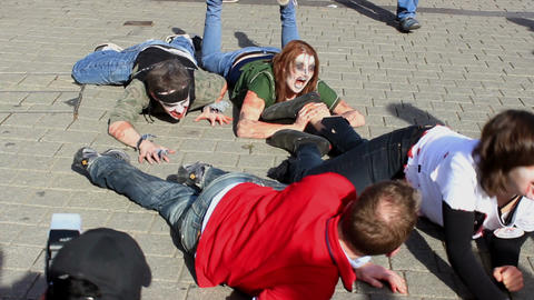 Hungry zombies lying on the pavement ビデオ