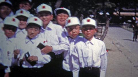 1972: Japanese school boys waving goodbye to foreign exchange teacher Footage