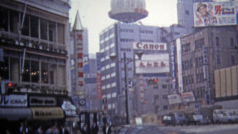1972: Urban downtown scenes of business men walking past technology billboards Footage