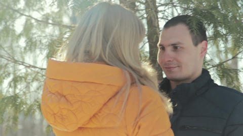 Couple of lovers on a date in park, standing face to... Stock Video Footage