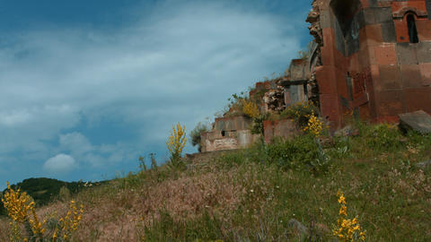 Red Brick Monastry Ruin On The Side Of A Hill stock footage