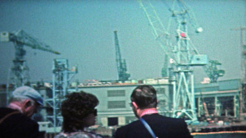 1972: Kyoto ocean shipping container cranes and high tech harbor Footage