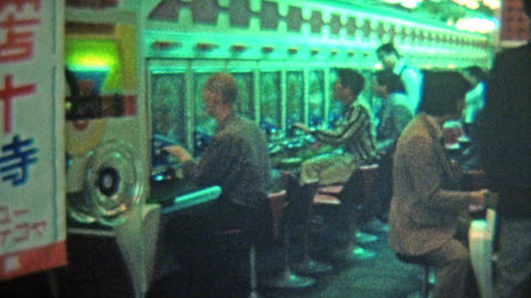 1972: Pachinko Japanese pinball machines crowd a downtown parlor Footage