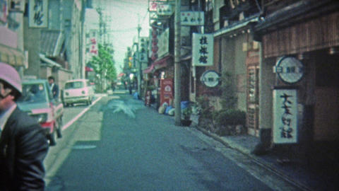 1972: Japanese Wooden Tourist Items And City Street stock footage