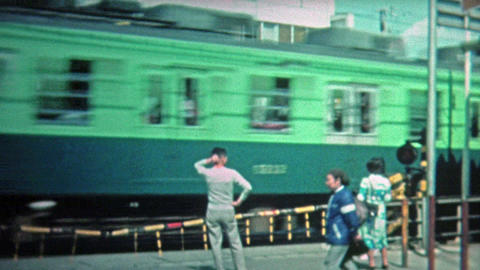 1972: Japanese train station and passing train scenes Footage