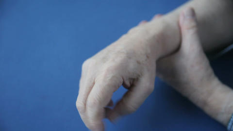 Hand numbness in senior man Footage