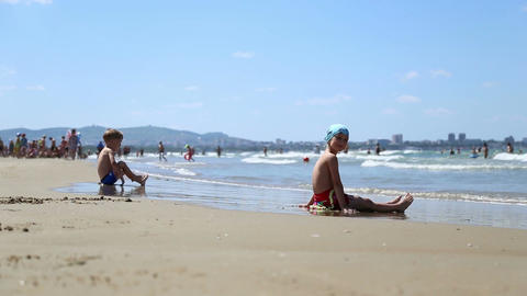 Little Girl And Boy Playing On The Shore Of The Black Sea stock footage