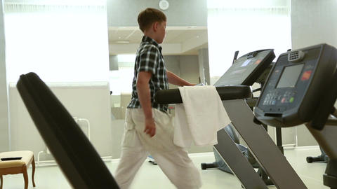 Boy running on the treadmill Footage