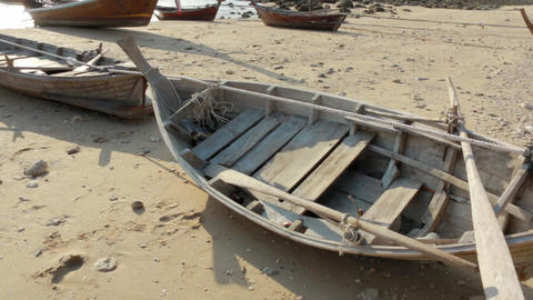 Small wooden rowing boat at a dry shore Footage
