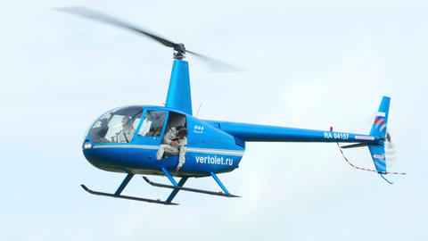 Helicopter Robinson R-44 before landing Live Action
