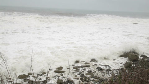 Stormy Sea During A Typhoon Waves Crashing On Rocks, Panning stock footage