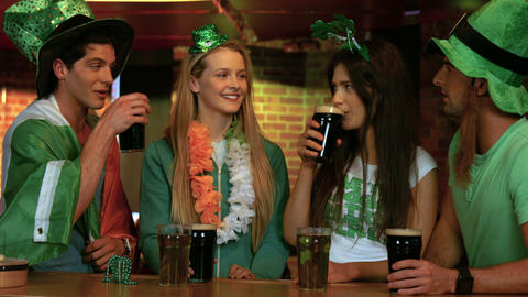 Happy friends celebrating st patricks day Filmmaterial
