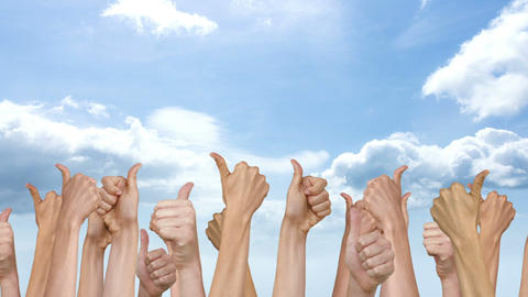 Many Thumbs Up Against Blue Sky stock footage
