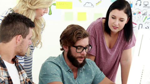 Casual business team brainstorming and using computer Footage