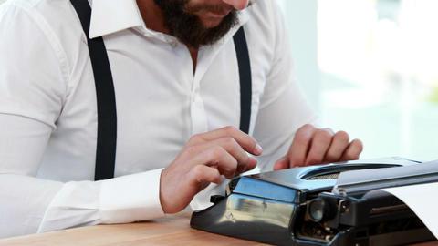 Hipster Businessman Using Typewriter stock footage