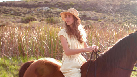 Pretty Woman Sitting On A Horse stock footage