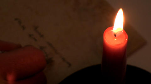 Writing by candlelight Footage