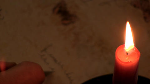 Writing by candlelight 4 Footage