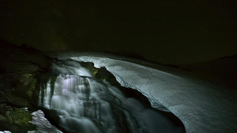 timelapse with waterfall surrounded by ice Footage