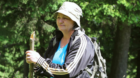 Senior Tourist Woman Walking In The Forest Close Up stock footage